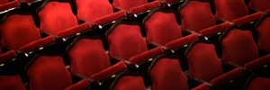 Photograph of red upholstered theater seats
