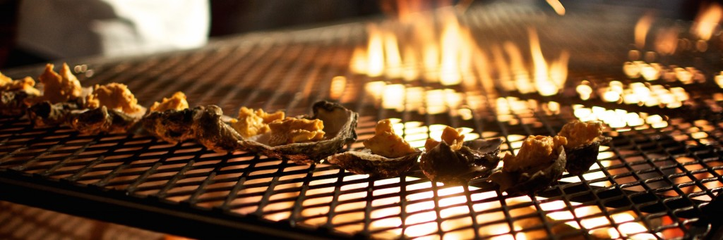 Photo of a barbecue grate with food and flames taken by John Tornow at Smoke Restaurant Dallas